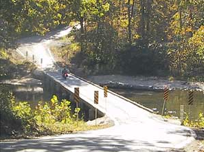 The gravel road and old wooden bridge at Patrick1