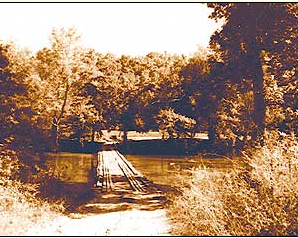 The gravel road and old wooden bridge at Patrick