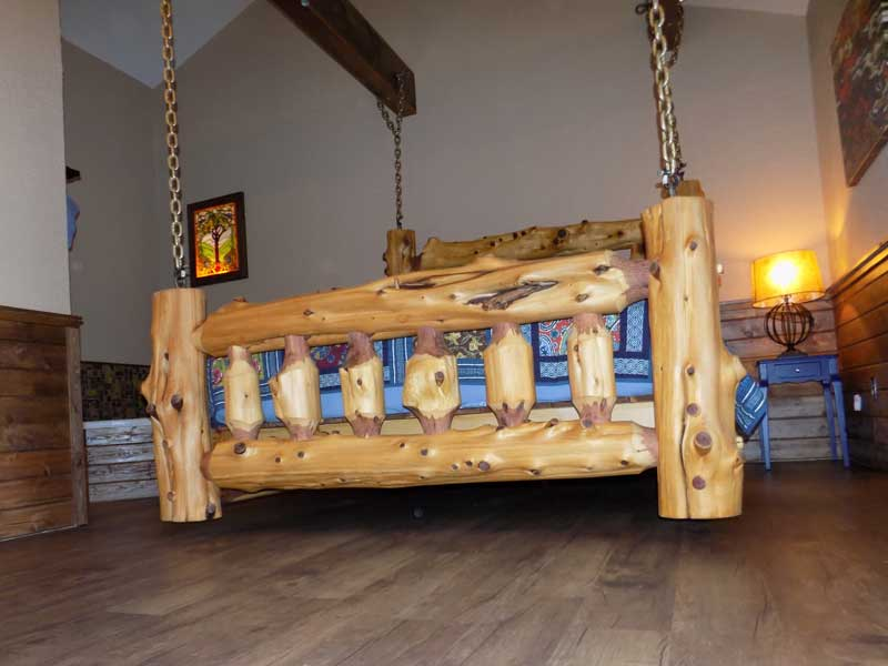 swinging log bed treehouse cabin